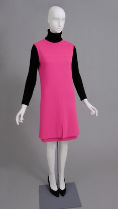 Woman's Ensemble: Dress and Turtleneck Under DressProbably designed by Pierre Cardin, French (born Italy), born 1922Probably made in France, EuropeDate:c. 1971Medium:Hot pink cotton blend double-knit, black wool knit, black silk satin
