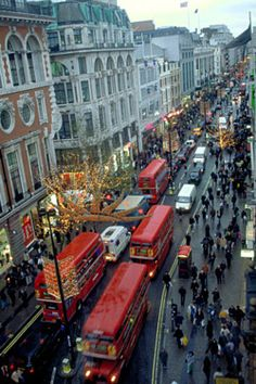 Oxford Street in London, England, at Christmastime. Oxford Street is not anywhere near the city of Oxford -which is about 60 miles/90 km north west of London- and is a major thoroughfare in the West End. Oxford Street is one of Europe's busiest shopping streets, with approximately 300 shops. I LOVE those little tiny people on the street shots and I have no idea why. Someone needs to psychoanalyse me. Then again, better not. (gettyimages.com)