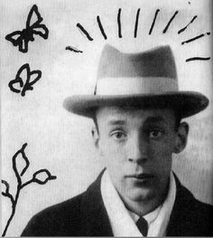 Picture of a young Vladimir Nabokov, with doodles done by the man himself.