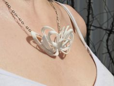 loving this ribbon jewelry collection and it's inspiration from magnetic field lines.