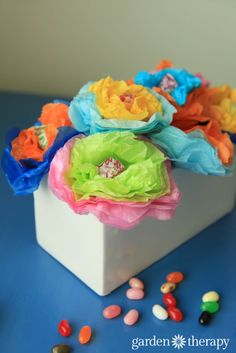 Plant magic jellybeans and grow these tissue paper + lollipop flowers!