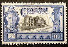 Ceylon KGVI 6c Stamp  CEYLON Stamp #296 Parliament Building A71 6c Deep Ultra & Black 1947 p11x12 Perf 11x12 Scott number - 296 Stamp Illustration No. - A71 Denomination 6c Color - Deep Ultra & Black Glue? No Cancellation Mark? Yes Overprinted? No