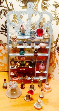 Gorgeous detail.  Handmade Dollhouse Designery perfume collection.  Swarovski crystals and other interesting elements create this unique group of dollhouse decorations.  Wooden stand by hand.