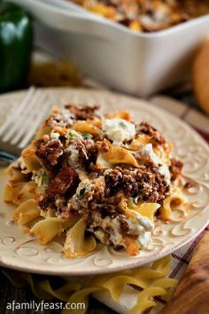 Hamburger Cheese Bake - A classic, family-friendly casserole with layered egg noodles, ground beef, tomato sauce, bell pepper and cheese.