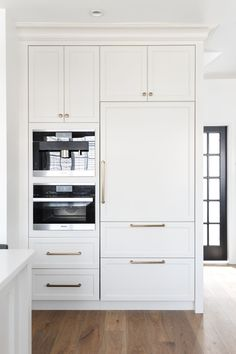 Stunning transitional taupe kitchen with Miele wall oven and hidden fridge by Chrissy Cottrell: Chrissy & Co