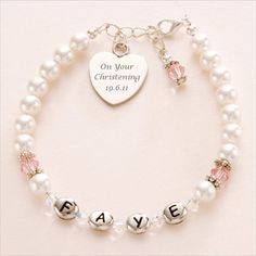 A lovely girls christening bracelet with birthstones, name and free engraving on the heart charm to make a truly unique personalised christening gift.
