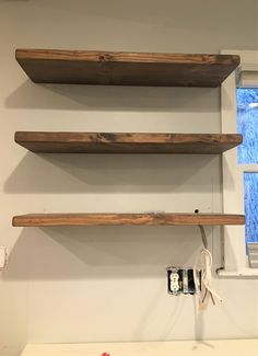 Floating shelves add a rustic but contemporary look to your home or work space. The solid wood shelves provide sturdy storage for books, dishes, or bathroom décor in a cozy, farmhouse style. Floating Shelves Bathroom, Rustic Floating Shelves, Solid Wood Shelves, Kitchen Wood Shelves, Bathroom Storage, Bookcase Wall, Bookshelf Design, Bookcases, Wall Shelves
