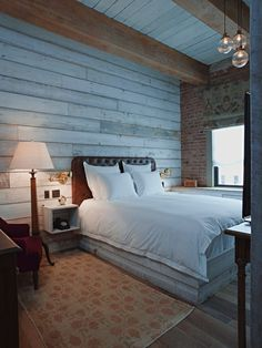 Bedroom With Wall of Reclaimed Wood