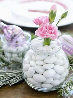 EASTER TABLE - Candies and Carnations -  Tuck dainty carnations into a slim florist's tube, and slip the tube inside a clear container filled with Jordan almonds for a surprising arrangement.