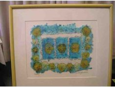 Pansy Framed Art - Hand made paper pansy art framed and matted by Darlene J. Cleveland. The fiber the paper is made from is abaca which comes from a type of banana tree. After the abaca is cooked, cleaned and pressed, then dyed and dried, the pieces are formed in a collage.