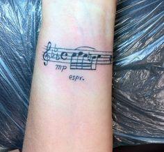 Hand Music Notes Tattoo