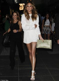 Leggy lady: Chrissy Teigen turned heads as she left the ABC Upfronts at the Mandarin Hotel...