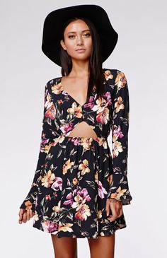 Bell Cutout Dress by Kendall & Kylie for PacSun and PacSun.com features a cutout detail with a button up front. We adore the retro bell sleeves and the bold floral print. Wear this stylish dress with some boots and accessorize with a cool hat!