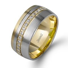 For the Groom:  A stunning 14K white and yellow gold band is comprised of .38ctw round white Diamonds.  Style #: LL121