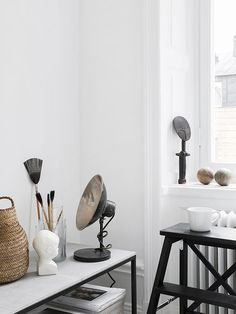 Industrial lamp and vintage artis's brushes in the dreamy home of Sara Medina Lindt