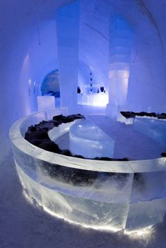 Ice beds, ice chairs, ice glasses... not only is the ICEHOTEL in Sweden made entirely of beautifully carved ice, but artists rebuild it every year after it melts in the spring! #travel
