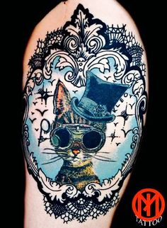 Cat with hat tattoo in to a frame ;)