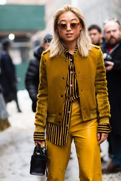 Margaret Zhang - mustard yellow leather stripes, street style  The Cut