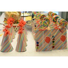 Goody bags and party hats for rainbow birthday party