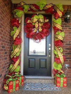 Amazing Decorated Christmas Trees | ... wreath, while a long swag and lighted potted trees frame the door