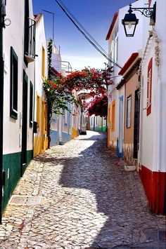 Algarve, Portugal, the old streets of Ferragudo - The Algarve area is the most popular tourist destination in all of #portugal. It's located in the south of the country and borders the Atlantic Ocean.