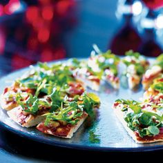 Easy parma ham and smoked mozzarella pizza slices to feed your party guests or snack on yourself.