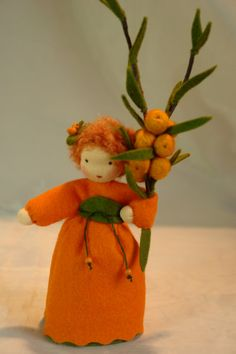Sea Buckthorn child-Waldorf inspired  The little Girl is made of 100 % wool-felt, fairy tale-wool and tricot material.  The doll is approx. 13,5 centimeters high  The filling is sheepwool