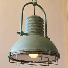 Antique turquoise pendant light - A little bit rustic and a whole lot of style. This antique pendant light with an aged turquoise finish will add a great touch