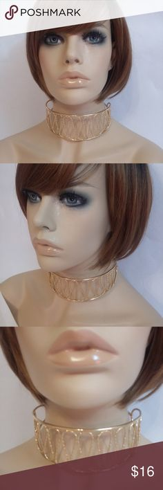 """Chunky Gold Hammered Metal Swirl Choker Necklace Gently worn, clean and in good pre-owned condition.  Length: 14"""" + chain Height: 2"""" Material:  Hammered Metal Features:  Swirl pattern, lobster clasp closure  No trades or modeling of clothing or accessories.  I will gladly provide additional measurements if needed. All items are from a smoke-free/pet-free home. Jewelry Necklaces"""