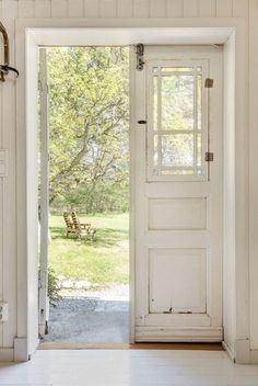 Double entrance doors with inset window that opens.