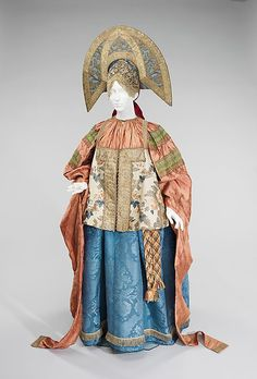 Ensemble, 19th century. Russian. Traditional Russian costume consists of straight, flowing lines. Beginning at the turn of the 18th century, the sarafan, a long, sleeveless dress, became the most popular article of peasant women's clothing in the Northern and Central regions of Russia. The sarafan is worn with a shirt, belt, and apron. In some areas, the epanechka, a short bodice identical in shape to the sarafan supplemented the basic ensemble.