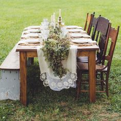 Lace edged table runners were lined with lush greenery and ivory candlesticks.
