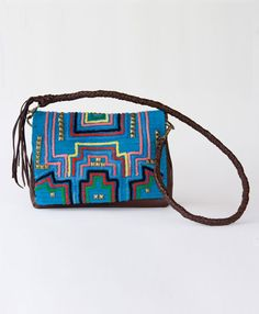 Edgy geometric studs combine with traditional Peruvian embroidery to create a bag that you won't want to leave home without.