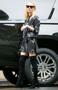 Kate Bosworth wears a black and white floral matching set with a skinny scarf and thigh-high suede boots