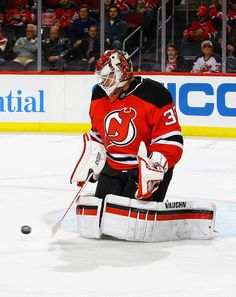 NEWARK, NJ - JANUARY 09: Cory Schneider #35 of the New Jersey Devils makes a save against the Florida Panthers during the game at Prudential Center on January 9, 2017 in Newark, New Jersey. (Photo by Andy Marlin/NHLI via Getty Images)