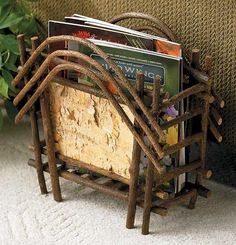"Keep all your favorite magazines neatly stored in this handsome birch bark and twig rack.    16""L x 11""H x 7""D."