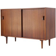 Compact Credenza by Stanley Young for Glenn of California | From a unique collection of antique and modern credenzas at https://www.1stdibs.com/furniture/storage-case-pieces/credenzas/