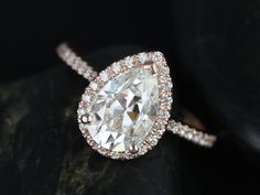 I just want this as a normal ring not an engagement ring. Tabitha Grande Size 14kt Rose Gold Pear FB Moissanite and Diamonds Halo Ring (Other metals and stone options available)