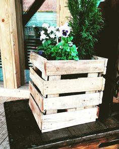 Planter cover made of pallet wood.