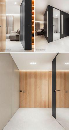 This apartment foyer has a hidden walk-in closet behind a mirrored door. #ApartmentDesign