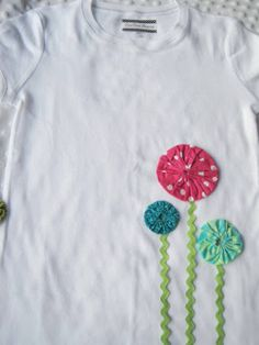 I've found another scrapbuster that I absolutely LOVE - Making fabric Yo-Yo's! Whenever I see a yo-yo, I think of a quilt my grandma made th...