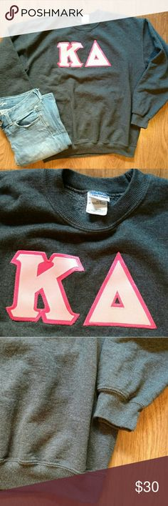 Kappa Delta Sweatshirt Kappa Delta grey sweatshirt size medium. This sweatshirt is in good condition. It is grey and the KD are two different shades of pink. The letters are sewn into the sweatshit. It is a crew neck with some cinching at the wrists and bottom. The arms are 23 inches. Bust is 21 inches. Length is 26 inches. The material is 50% cotton, 50% polyester. Gildan Sweaters Crew & Scoop Necks