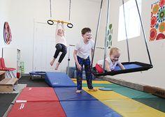 Garage gymnastics equipment. Living With Kids: Camille Turpin
