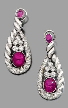 A pair of ear pendants, by Suzanne Belperron, circa 1936. Each set with ruby cabochons and diamonds, mounted in platinum. #Belperron #vintage #earrings