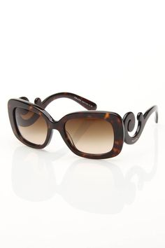 Prada Sunglasses In Tortoise.