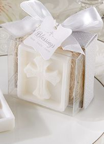 "A meaningful favor for so many occasions, our ""Blessings"" cross soap brings a very special message to family and friends.  Feature and Facts:  White, sculpted cross soap that is lightly scented with a fresh fragrance.  Gift presentation includes clear display box with a delicate silver-and-white pattern, natural shredded raffia, and a white-satin bow at the top.  Gift box measures 2 1/4"" h x 2"" w."