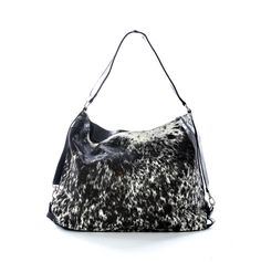 The Lola cowhide tote shopper by Mooi is a gorgeous large soft shoulder bag that you can fit a massive amount of stuff in. Carry your whole world with you while looking stylish and chic. The sides have a great strap detail with silver clasps that look a bit like a horse's brindle. And the open top closes with a single magnetic button clasp. Dimensions H:34cm x L:50cm x W:10cm