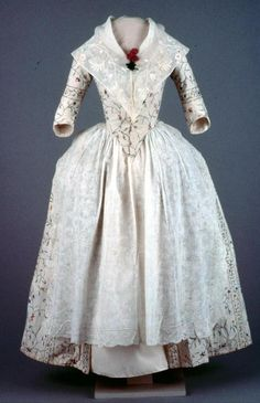 """Robe à l'anglaise: ca. 1780, English, silk needlework on cotton, bodice and sleeves lined with linen, reproduction petticoat. """"Mannequin accessorized with 1991-523 [whitework apron] and 1982-162 (fichu?)."""" [Search for Acc. No. 1991-467]"""