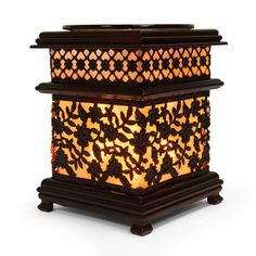 """Brown Metal Asian Floral Style Oil Warmers THESE BROWN METAL ASIAN FLORAL STYLE OIL WARMERS ARE 6"""" TALL. ADD RELAXATION AND TRANQUILITY TO YOUR HOME. THE DISH IS REMOVABLE FOR EASY CLEAN UP. USES ONE 35 WATT HALOGEN BULB (INCLUDED). POWER CORD MEASURES 5' IN LENGTH AND HAS DIMMER SWITCH ALLOWS YOU TO CONTROL THE INTENSITY OF THE LIGHT TO WARM THE OIL TO YOUR DESIRED FRAGRANCE LEVEL."""