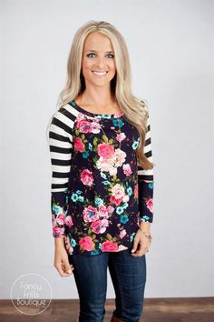 Looking for the perfect tunic to add a little flair to your Fall and Winter wardrobe? Look no further! This top is the perfect mix of classic and trendy. The length is perfect for leggings, and the flattering fit is sure to turn heads! We love the fun colors and adorable floral and striped pattern :) The rayon material is super comfy, and of amazing quality. Runs true to size.Sizing:SM 0-4Med 4-8Large 8-12Model is wearing a size small.